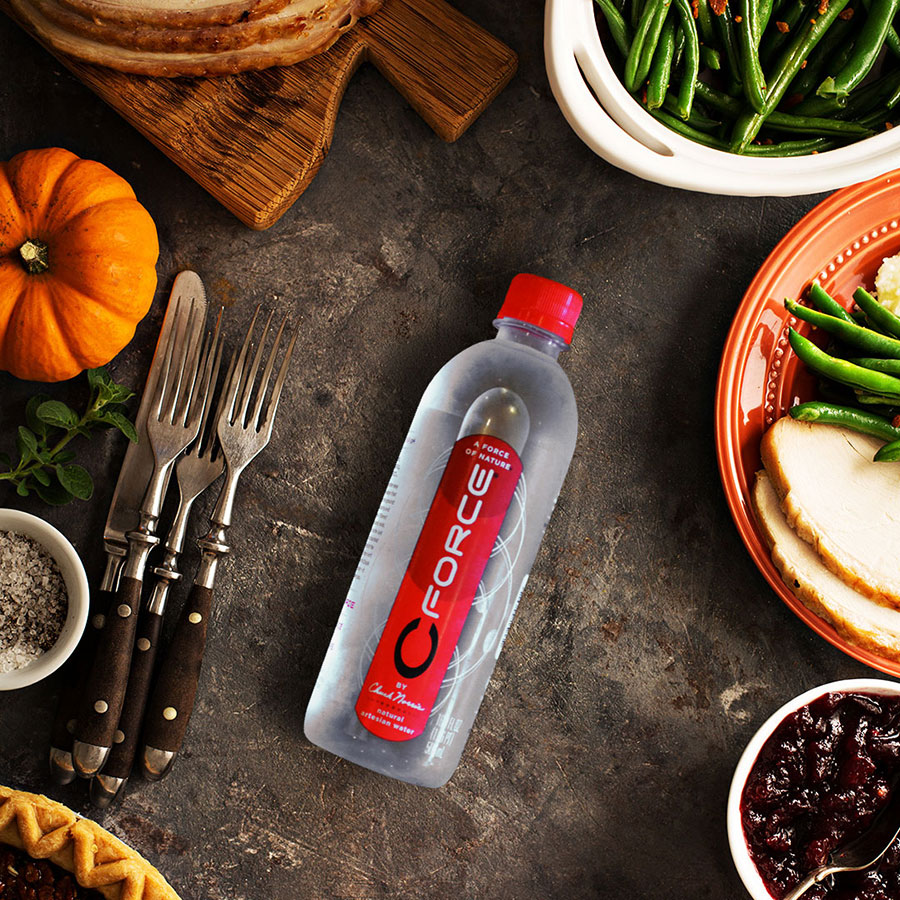 CForce water sitting on table with healthy food ingredients