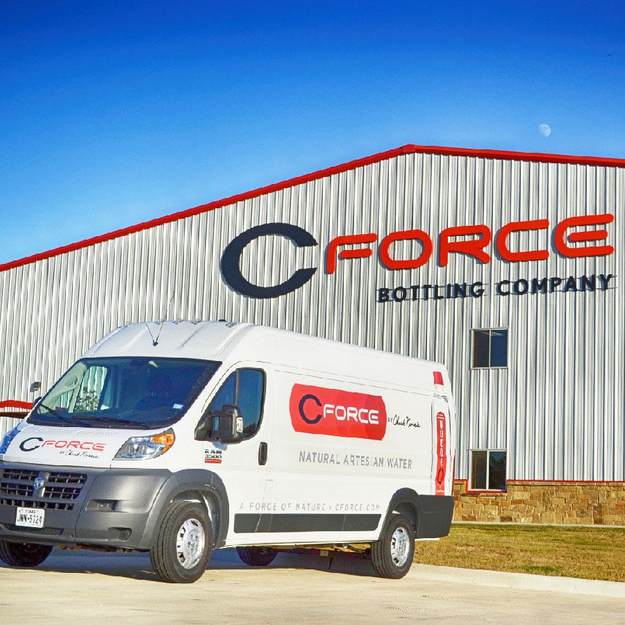 CForce bottling company facility with branded company van