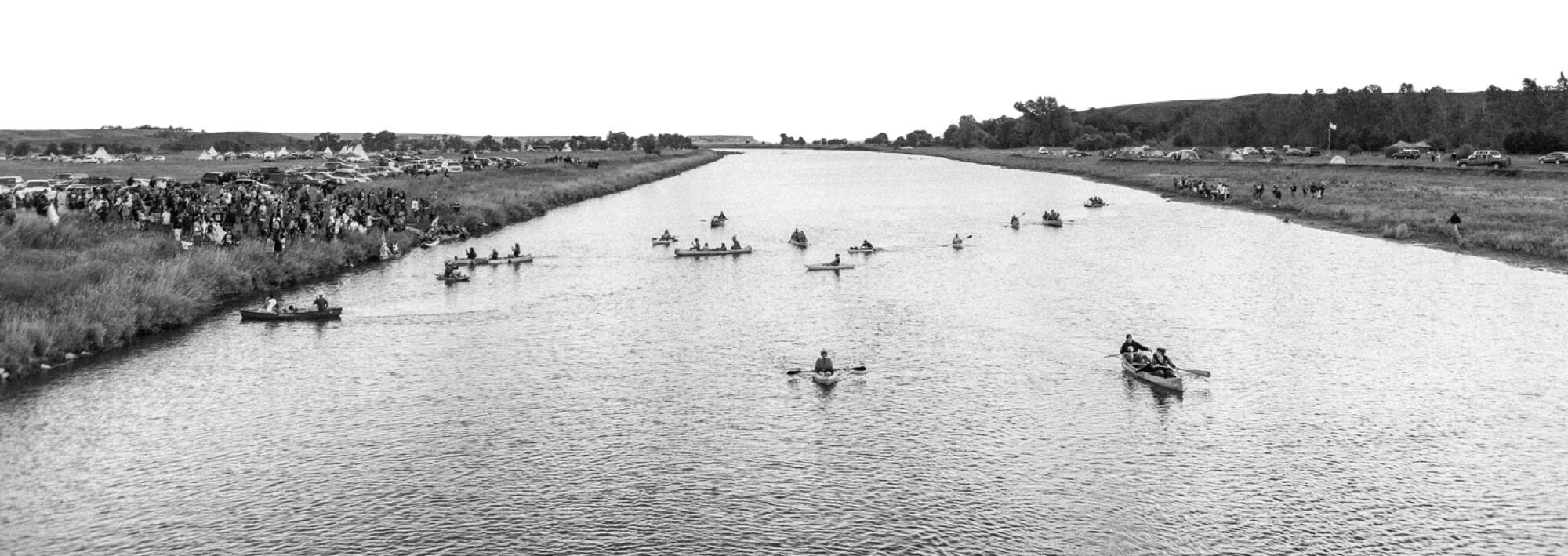 a black and white image of a river