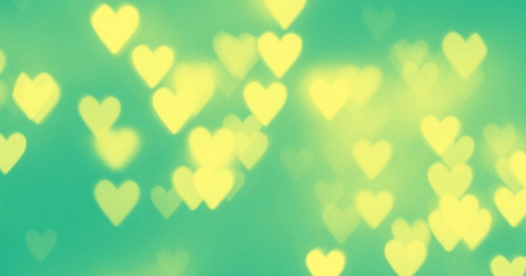 bokeh hearts on a green background