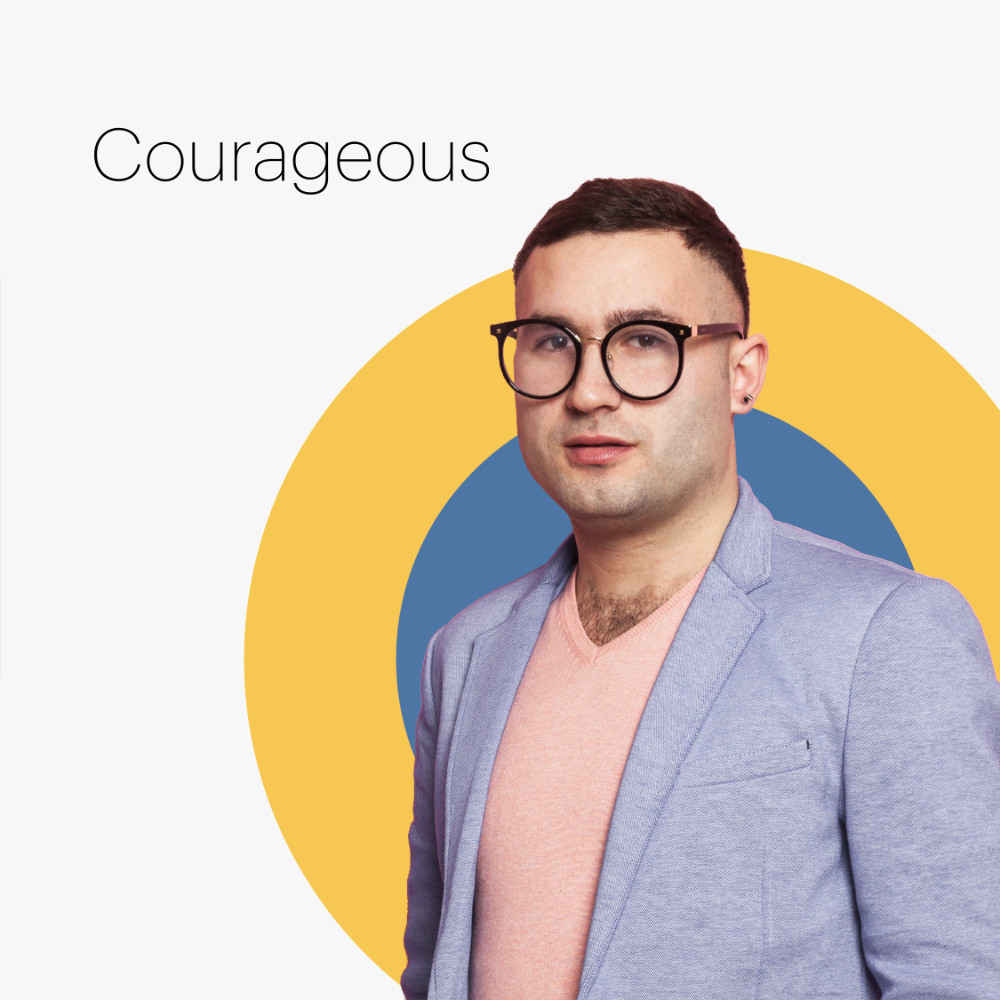 man on multicolored circles with the word courageous