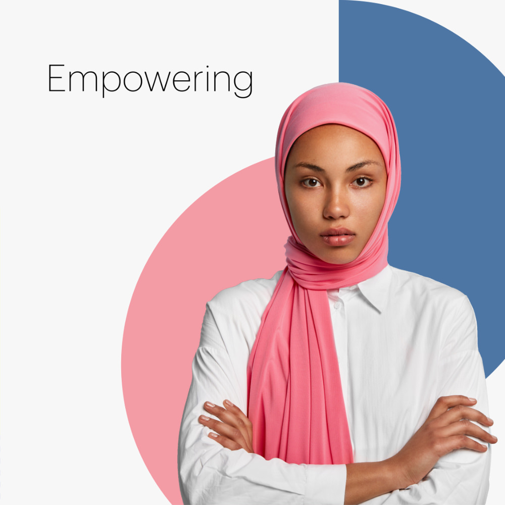 a woman in a hijab with the word empowering