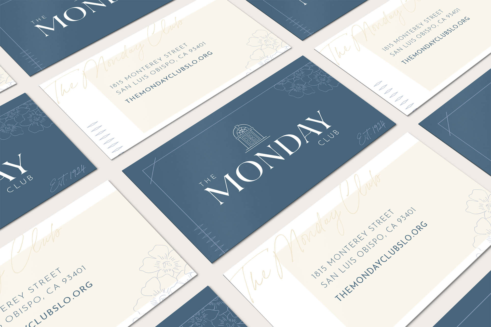 The Monday Club business cards flat lay