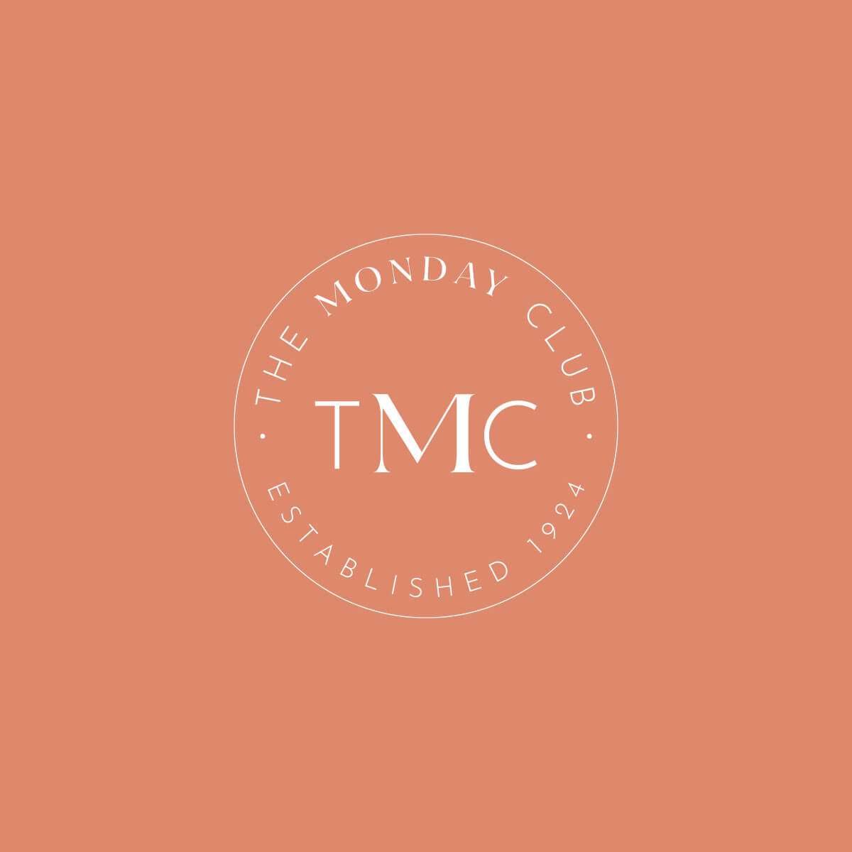 The Monday Club seal logo on a salmon background